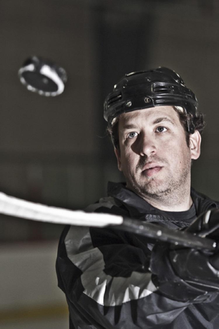 Hockey Coach Displaying Skills © Stewart Hyman