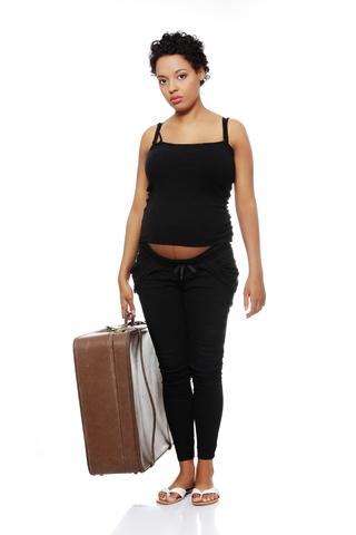 Pregnant woman holding a case © Piotr Marcinski