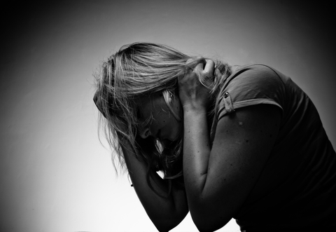 Sad Woman Sitting Alone © Bewuel