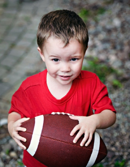 Boy Clutching American Football - © Shsphotography