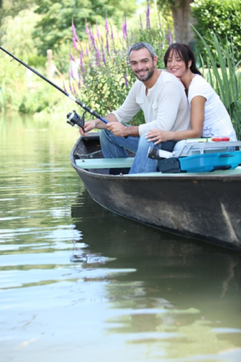 Couple Fishing on a Boat in the River © Auremar.jpg