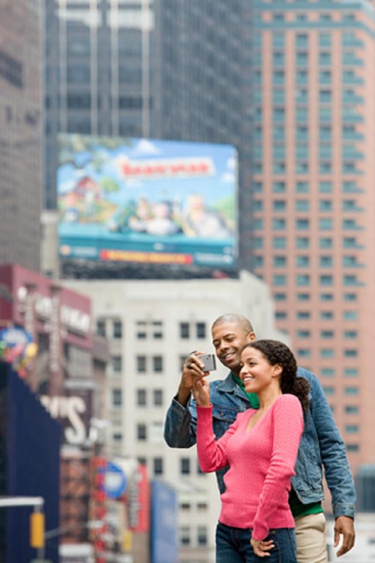 Cute Couple Using Digital Camera - © Xixinxing