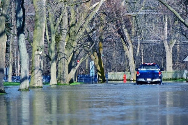 Flooded Suburb Street - © Welcomia