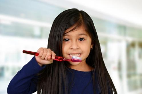 Girl Brushing Teeth -  © Rmarmion