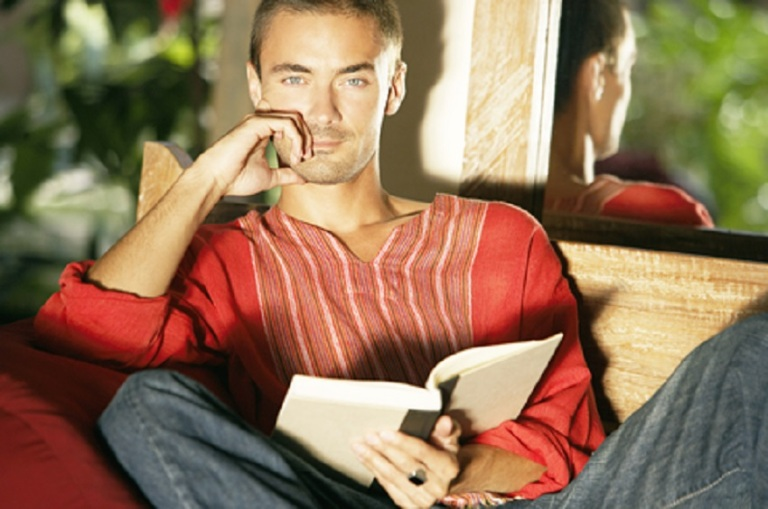 Man Reading a Book While on Tropical Vacation - © Mjth
