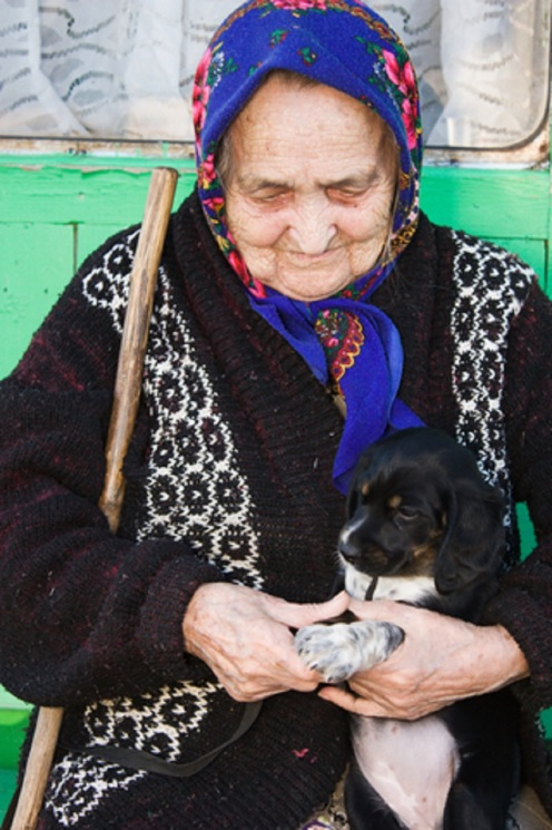 Senior Lady With Puppy - © Khamidulin
