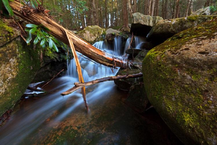 Steam and Waterfalls in the Mountains © Calin Tatu