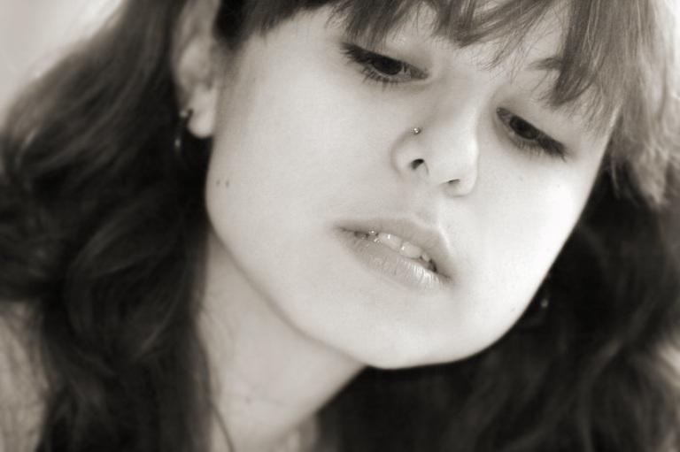 Teen Girl Looks Down - © Galina Barskaya