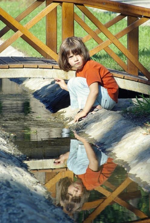 Upset Girl By Creek © Rigmanyi