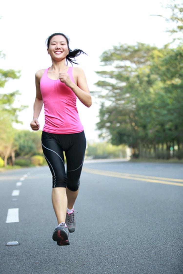 Woman Running Through The Park - © Uptall