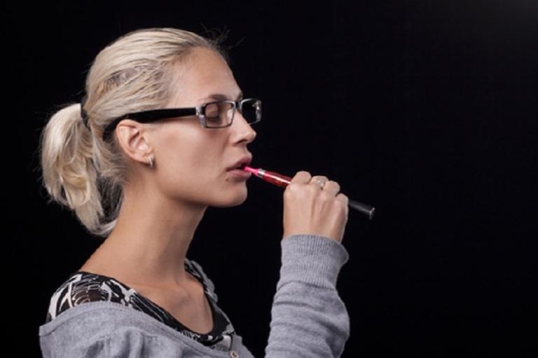 Woman Smoking E-Cigarettes © Goldy83