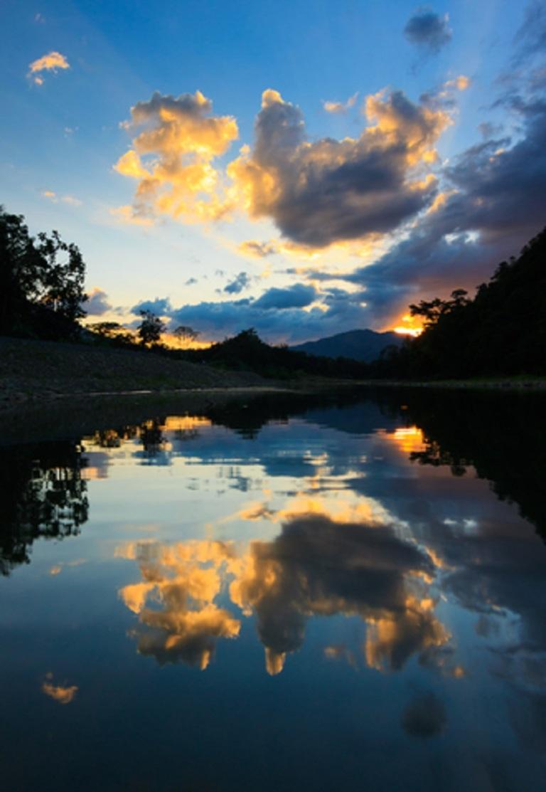 Beautiful reflection of sunset and clouds at Sabah, Borneo, Malaysia  © Macbrian Mun.jpg