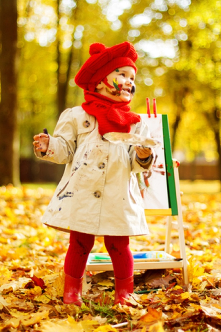 Child drawing on easel in Autumn Park © Inara Prusakova