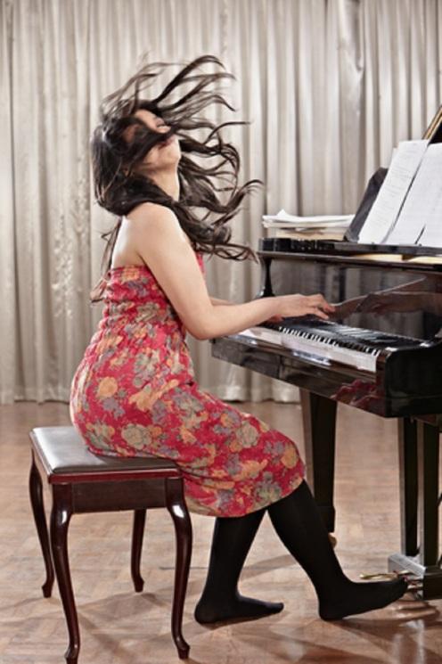 Playing Piano © Otnaydur