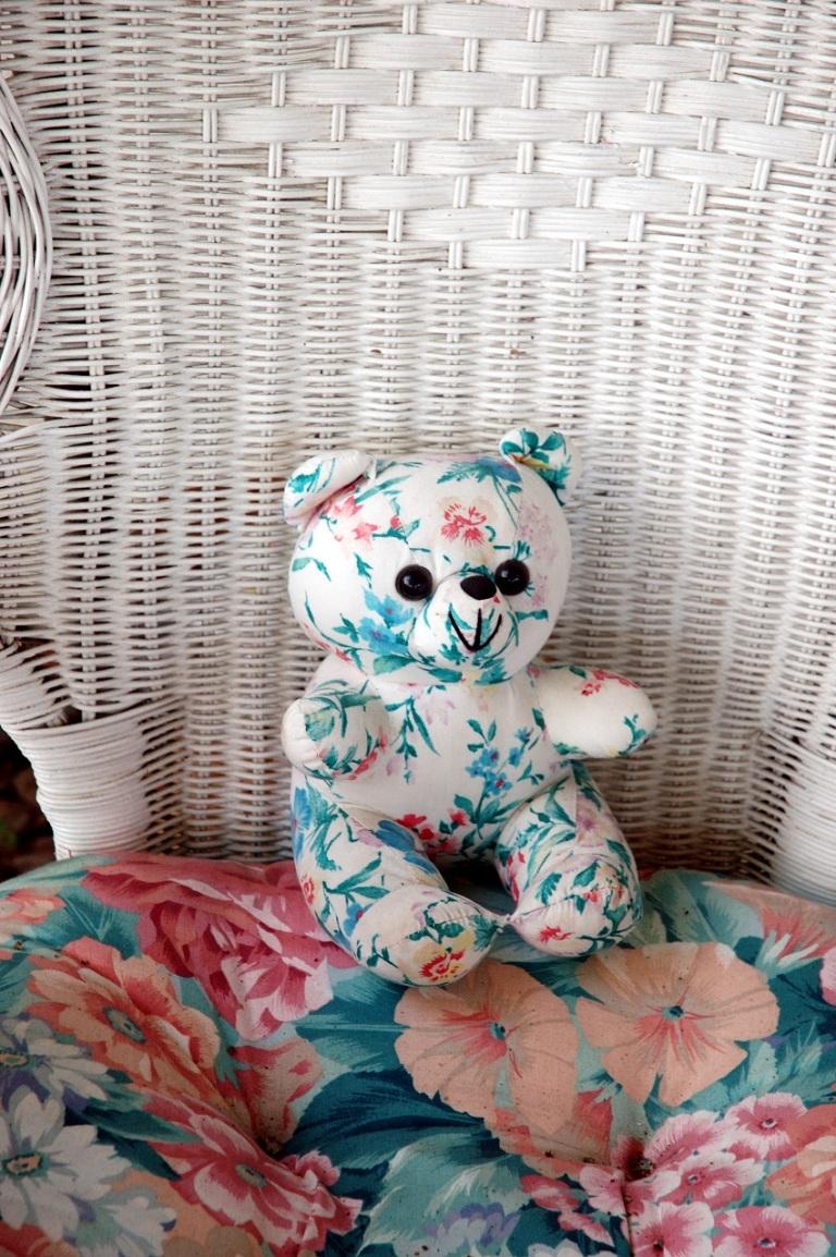 Stuffed Bear In a Wicker Chair © Photoeye
