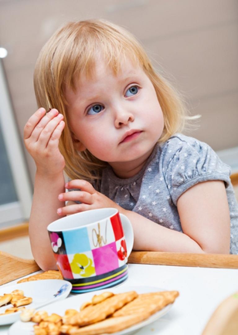 Small Girl Eating Cookies © S-dmit.jpg