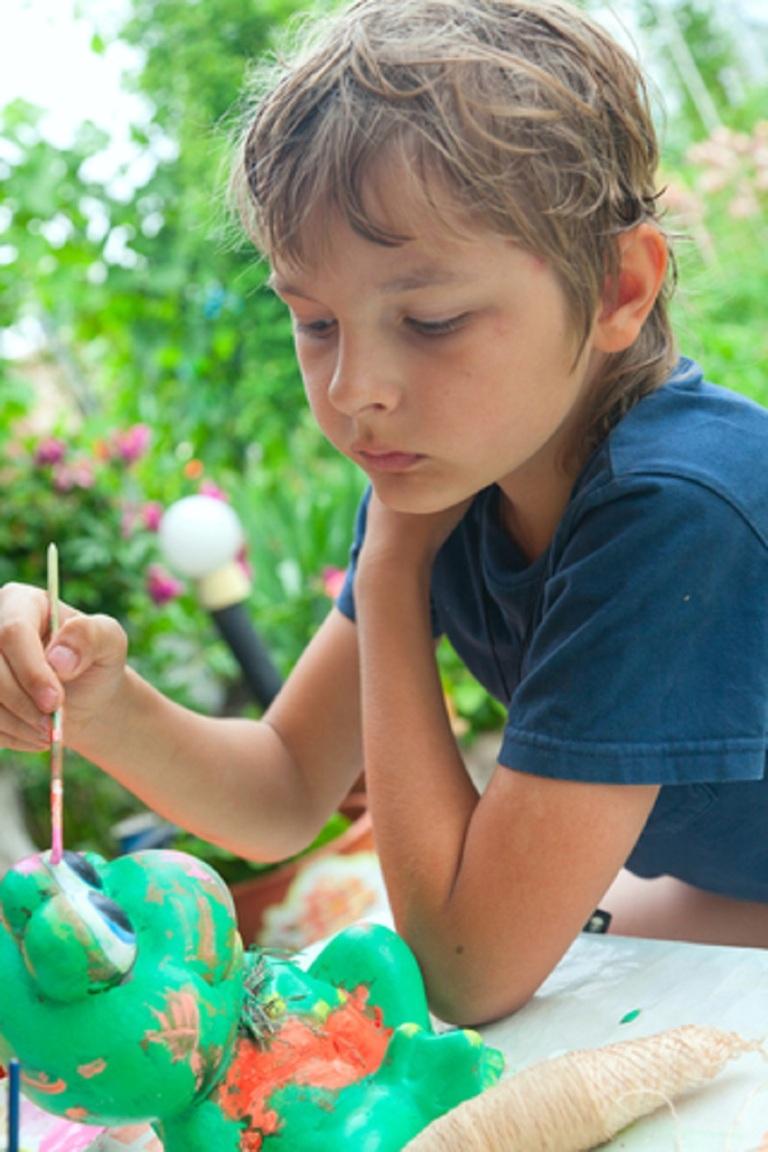 Boy Painting Frog With A Brush © Aleksandr Frolov.jpg